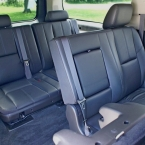 Middle back rows of seating in Chevrolet Suburban executive SUV from Echo Limousine in Chicago, IL