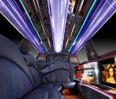 Interior of Echo Limousine stretch limo with ceiling lights and carpeted flooring in Chicago, IL