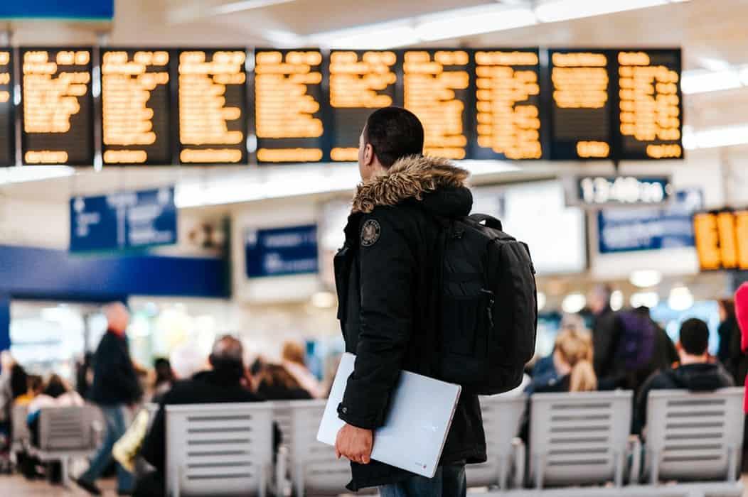 A man walking through an airport