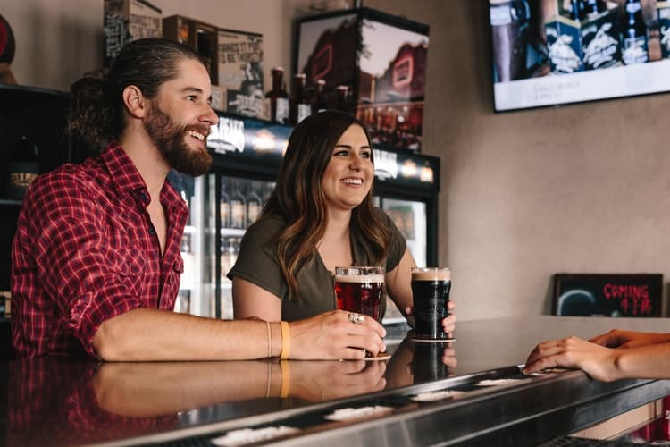 Couple Drinking Beer Touring Chicago's Best Breweries